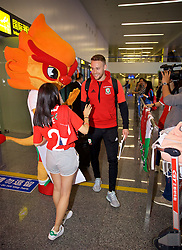 NANNING, CHINA - Monday, March 19, 2018: Wales supporters greet Chris Gunter as they arrive at Nanning International Airport for the 2018 Gree China Cup International Football Championship. (Pic by David Rawcliffe/Propaganda)