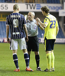 Referee Scott Mathieson speaks to Millwall's Steve Morison and Birmingham City's Jonathan Spector after thye clash - Photo mandatory by-line: Robin White/JMP - Tel: Mobile: 07966 386802 15/03/2014 - SPORT - FOOTBALL - The Den - Millwall - Millwall v Birmingham City - Sky Bet Championship
