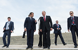 French President Emmanuel Macron and President of the Russian Federation Vladimir Putin walking in the garden of the Chateau de Versailles an than Macron driving a golf car with Putin in Versailles, France on may 29, 2017. Photo by Jacues Witt/Pool/ABACAPRESS.COM