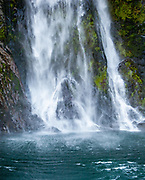 Stirling falls drops into Milford Sound, Fiordland National Park, New Zealand.