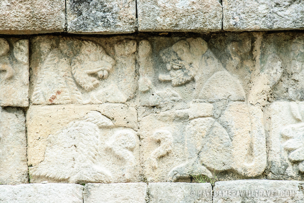 Carvings of jaguars on the walls of the Western Colonnade at Chichen Itza Archeological Zone, Chichen Itza, Mexico.