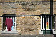 Clothes and fruit in the cell windows of D wing of Wandsworth Prison. HM Prison Wandsworth is a Category B men's prison at Wandsworth in the London Borough of Wandsworth, South West London, United Kingdom. It is operated by Her Majesty's Prison Service and is one of the largest prisons in the UK with a population over 1500 people. (photo by Andy Aitchison)