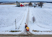 A farmer heads to his farm with a load of corn after combining a field in early winter near Potter, Wisconsin.