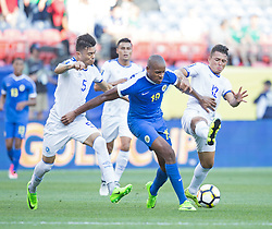 July 13, 2017 - Denver, Colorado, U.S - Curacao F RANGELO JANGA, center, runs into El Salvador traffic trying to get control of the ball during the 1st. Half at Sports Authority Field at Mile High during the CONCACAF Gold Cup tournament Thursday night. El Salvador beats Curacao 2-0. (Credit Image: © Hector Acevedo via ZUMA Wire)