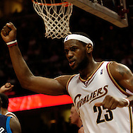 LeBron James pumps his fist after making a layup in traffic while being fouled by Dallas last night.