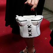 NLD/Amsterdam/20080513 - FHM 100 Sexiest vrouwen 2008, Aukje van Ginneken tasje in de vorm van een corset