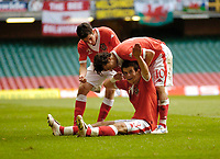 Photo: Leigh Quinnell.<br /> Wales v Slovakia. UEFA European Championships 2008 Qualifying. 07/10/2006. Gareth Bale is congratulated for his goal for Wales by teammates Simon Davies(R) and Richard Duffy.