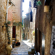 "PITIGLIANO, ITALY - OCTOBER 23: A view of the narrow streets in Pitigliano, a small village located in Tuscany halfway from Florence and Rome, perched atop a volcanic tufa ridge. Its unmistakable skyline makes it stand out. Pitigliano is a truly unique village in southern Tuscany, in the less-known Maremma district. The town is dubbed ""la citta' di tufo"" for the rock that it not only is built on.<br /> The village is also called ""Little Jerusalem"", not just because it looks ancient and bears a resemblance to that city, but also for the long presence of a Jewish community in the town. Pitigliano, Tuscany, Italy. 23rd October 2017. Photo by Tim Clayton/Corbis via Getty Images)"