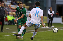 Republic of Ireland's Lee O'Connor (left) and Luxembourg's Leon Schmit battle for the ball during the UEFA Under-21 Championship Qualifying Round Group F match at the Tallaght Stadium, Dublin. Picture date: Friday October 8, 2021.
