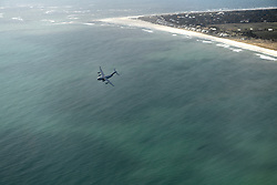 A C-17 Globemaster III aircraft flies over the N.C. coastline on the way to the North Carolina Air National Guard Base, Charlotte Douglas International Airport, April 7, 2018. The airframes homecoming will be marked by an acceptance ceremony. The 145th Airlift Wing was selected to transition from the C-130 Hercules aircraft to the C-17 aircraft 18 months ago, and the airframe will carry the units airlift mission into the future. The first two aircraft of eight to come to the 145th AW were previously assigned to the active duty wings at Joint Base Charleston, S.C. or Joint Base Lewis-McChord, Wash. (U.S. Air Force photo by Tech. Sgt. Julianne Showalter)