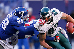 11 Jan 2009: Philadelphia Eagles tight end L.J. Smith #82 runs the ball and is tackled by New York Giants linebacker Antonio Pierce #58 during the game against the New York Giants on January 11th, 2009.  The  Eagles won 23-11 at Giants Stadium in East Rutherford, New Jersey. (Photo by Brian Garfinkel)