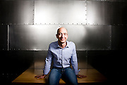 Portrait of Jeff Bezos, CEO of Amazon.com.  Photographed at Amazon.com offices in Seattle, WA. Stainless steel wall backdrop.