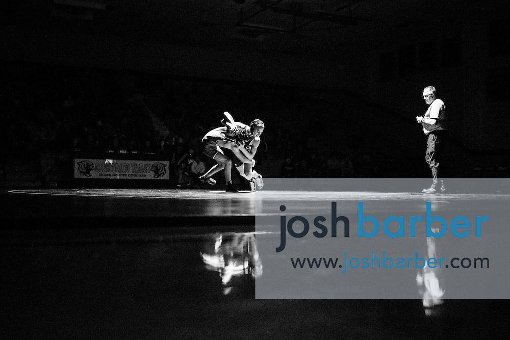 Capistrano Valley's Noah Holmes, Aliso Niguel's John DeCorte, Brad Fahring during Sea View league wrestling at Capistrano Valley High School on Thursday, January 14, 2016 in Mission Viejo, California. Capistrano Valley won 43-22. (Photo/Josh Barber)