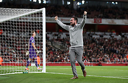 A Brentford fan on the pitch during the Carabao Cup, Third Round match at the Emirates Stadium, London.