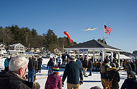 A plane comes in for a landing on Lake Winnipesaukee at Alton Bay during Winter Carnival festivities on Sunday afternoon.  (Karen Bobotas/for the Laconia Daily Sun)