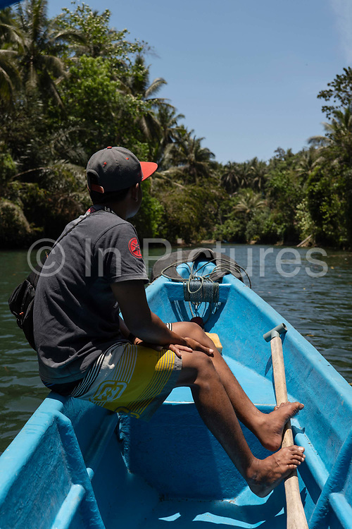 A male guide looks out to the Green Canyon near Pangandaran on the 30th October 2019 in Java in Indonesia.