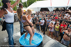 Wet T-shirt competition on the Roadhouse main stage during Laconia Motorcycle Week 2016. NH, USA. Friday, June 17, 2016.  Photography ©2016 Michael Lichter.