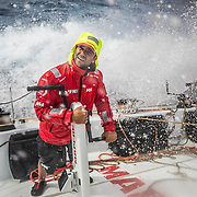 Leg 4, Melbourne to Hong Kong, day 13 on board MAPFRE, Pablo Arrarte holded to the mid pedestal to don't be brought by the water, he was talking with Xabi. Photo by Ugo Fonolla/Volvo Ocean Race. 13 January, 2018.