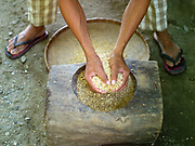 Farmer Gary Castanares hand mills SRI rice at home in Daguma village, Bagaubayan, Sultan Kudarat province, Mindanao Island, The Philippines. Gary attended Oxfam's field school where he learnt about SRI (System of Rice Intensification) farming. Hand milling rice retains all of the vitamins and minerals and tastes better but it is very labour intensive.