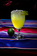 A gold margarita with lime and salt.