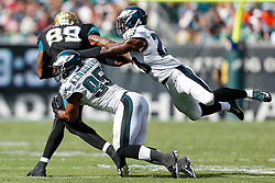 Philadelphia Eagles free safety Earl Wolff #28 and inside linebacker Mychal Kendricks #95 tackle the ball carrier during the NFL Game between The Jacksonville Jaguars and the Philadelphia Eagles at Lincoln Financial Field in Philadelphia on Sunday September 7th 2014. The Eagles won 34-17. (Brian Garfinkel/Philadelphia Eagles)