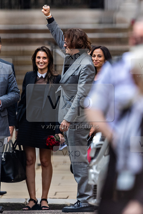 """American actor and Hollywood star Johnny Depp, gestures and waves as he and his legal team leave the Royal Courts of Justice in central London on Tuesday, July 28, 2020.<br /> <br /> An article in the Sun describing Johnny Depp as a """"wife-beater"""" was """"one-sided"""" and """"not researched at all"""", the actor's lawyer told the High Court. In closing submissions for Mr Depp, David Sherborne said the paper acted as """"both judge and jury"""". Mr Depp is suing the newspaper's publisher and editor for libel, saying the allegation is """"completely untrue"""". (VXP Photo/ Vudi Xhymshiti)"""