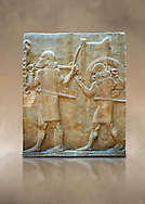 Stone relief sculptured panel of soldiers carrying a war chariot . Facade L. Inv AO 19884 from Dur Sharrukin the palace of Assyrian king Sargon II at Khorsabad, 713-706 BC.  Louvre Museum Room 4 , Paris .<br /> <br /> If you prefer to buy from our ALAMY PHOTO LIBRARY  Collection visit : https://www.alamy.com/portfolio/paul-williams-funkystock/ancient-assyria-antiquities.html  Refine search by adding background colour, place, subject, museum etc into the LOWER SEARCH WITHIN GALLERY box to <br /> <br /> Visit our ANCIENT WORLD PHOTO COLLECTIONS for more photos to download or buy as wall art prints https://funkystock.photoshelter.com/gallery-collection/Ancient-World-Art-Antiquities-Historic-Sites-Pictures-Images-of/C00006u26yqSkDOM