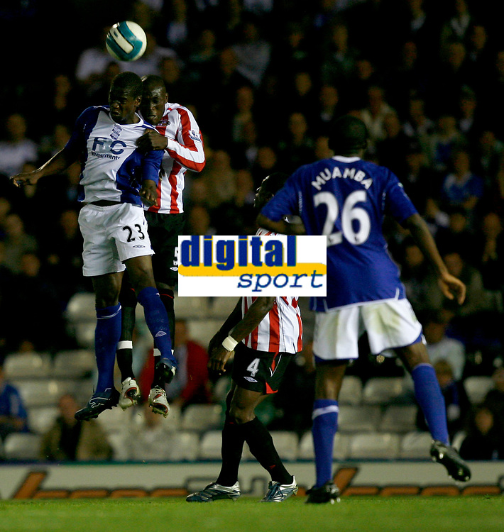 Photo: Steve Bond.<br />Birmingham City v Sunderland. The FA Barclays Premiership. 15/08/2007. Nyron Nosworthy (back) in an aerial duel with Olivier Kapo (front)