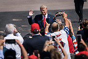 President Donald Trump greets the crowd during a campaign rally at North Star Aviation in Mankato, Minnesota on Monday, Aug. 17, 2020.
