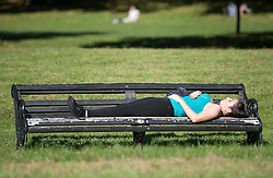 © licensed to London News Pictures. London, UK  30/09/2011. A woman sleeping on a park bench in sunshine in Hyde Park, London today (30/09/2011) as a heatwave continues throughout the Britian setting record temperatures for September. Photo credit London News Pictures