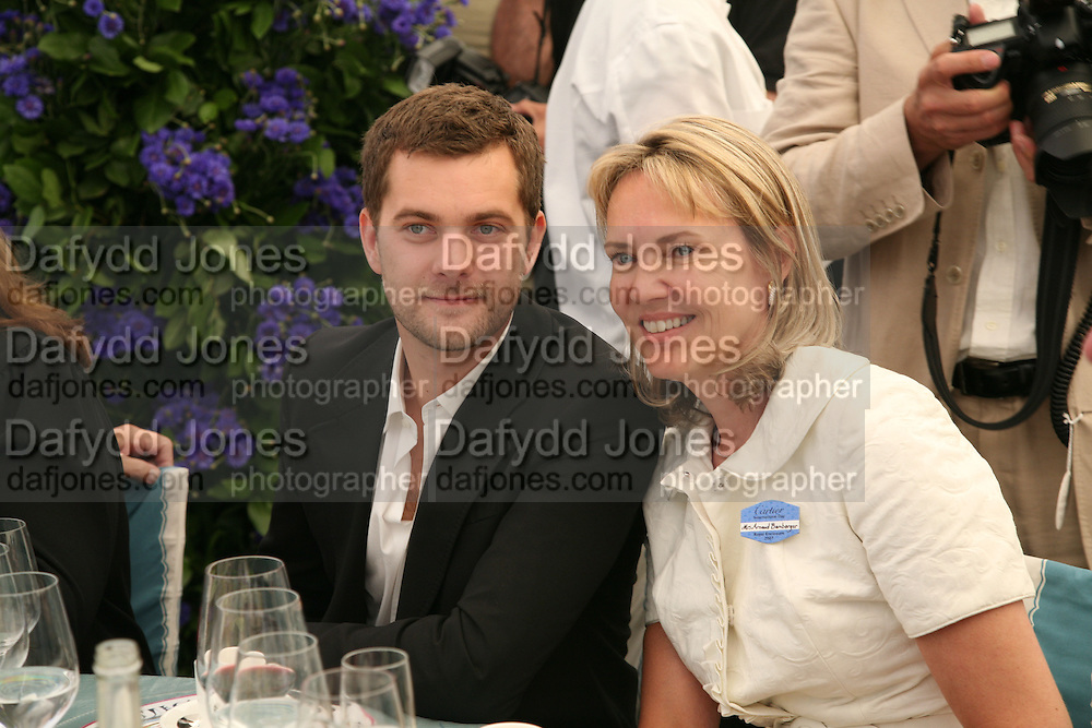 Joshua Jackson and Mrs. Arnaud Bamberger, Cartier International Polo. Guards Polo Club. Windsor Great Park. 29 July 2007.  -DO NOT ARCHIVE-© Copyright Photograph by Dafydd Jones. 248 Clapham Rd. London SW9 0PZ. Tel 0207 820 0771. www.dafjones.com.