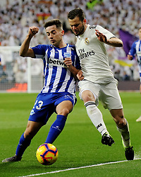 MADRID, Feb. 4, 2019  Real Madrid's Nacho Fernandez (R) vies with Alaves' Jony Rodriquez during a Spanish La Liga match between Real Madrid and Alaves in Madrid, Spain, on Feb. 3, 2019. Real Madrid won 3-0. (Credit Image: © Edward F. Peters/Xinhua via ZUMA Wire)