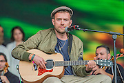 Damon Albarn (pictured) introduces and plays with the Orchestra of Syrian Musicians on the Pyramid Stage - The 2016 Glastonbury Festival, Worthy Farm, Glastonbury.