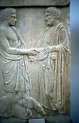 Athenian youth greeting older man. Relief. 5th century BC