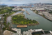 """The natural wild and meandering Duwamish River was """"tamed"""" by dredging, filling and straightening that destroyed 98 percent of its natural abundance. Only one natural bend in the river remains, flowing around Kellogg Island, center. It is surrounded by industry and other evidence of the choices made about 100 years ago by city planners and developers, who also drove out the Indian tribes that lived in prominent villages on this spot."""