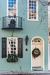 December 21, 2017 - Charleston, South Carolina, United States of America - A white wooden door of a historic home decorated with a Christmas wreath and palmetto roses on Tradd Street in Charleston, SC. (Credit Image: © Richard Ellis via ZUMA Wire)
