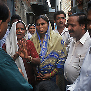 Health workers face major obstacles as some communities are refusing polio immunization due to superstition and fear. Here, a team of doctors in the crowded Karula area of Moradabad city (Uttar Pradesh) is trying to convince local Muslim women that the death of a boy in the family was not due to the polio vaccine.