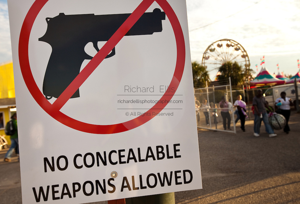A sign forbidding concealed weapons at the South Carolina Coastal Fair in Charleston, SC.