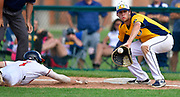 Edwardsville baserunner Evan Funkhouser dives safely back to first base to avoid a pickoff throw to OFallon first baseman Corey Quintal. OFallon defeated Edwardsville in a baseball sectional playoff game at Edwardsville High School in Edwardsville, IL on Wednesday June 9, 2021. <br /> Tim Vizer/Special to STLhighschoolsports.com.