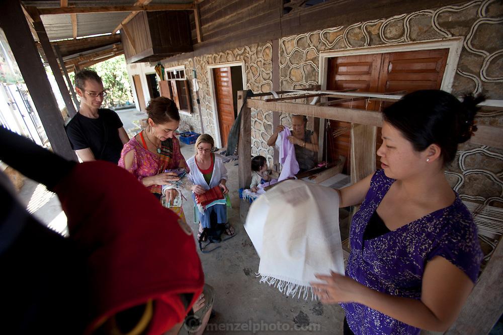 Weavers at Ban Pha Nom, near Luang Prabang, Laos.