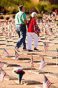 30 MAY 2011 - PHOENIX, AZ: A couple walks through the cemetery on their way to Memorial Day services in the National Memorial Cemetery in Phoenix, AZ, Monday. Memorial Day was celebrated with services across the United States Monday.    Photo by Jack Kurtz