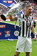 Match winner Steve Morison of Millwall poses with the League 1 Play Off Trophy. EFL Skybet football league one play off final match, Bradford city v Millwall at Wembley Stadium in London on Saturday 20th May 2017.<br /> pic by Steffan Bowen,  Andrew Orchard sports photography.