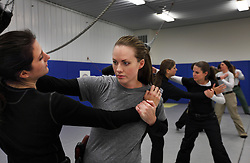 Meghan Mulherin, a member of Hillary Clinton's security detail, takes part in training drills at a training facility in Summit Point, W.Va on Dec. 16, 2011.