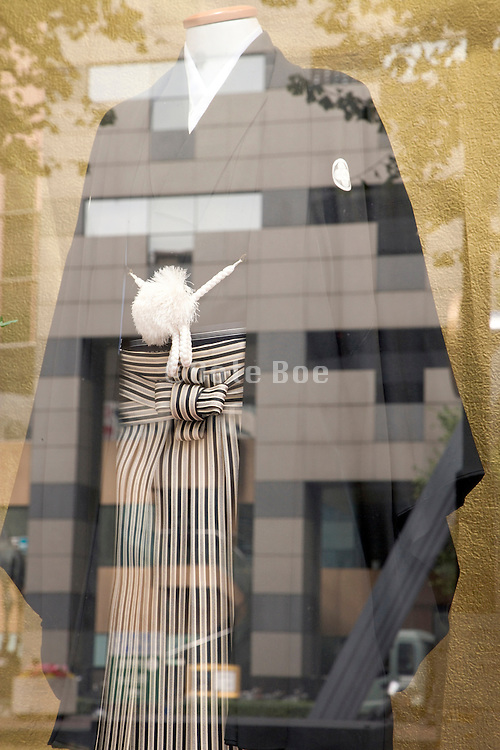 a male wedding kimono displayed in the window of a Japanese retail store in Tokyo