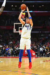 December 21, 2018 - Los Angeles, CA, U.S. - LOS ANGELES, CA - DECEMBER 20: Dallas Mavericks Guard Luka Doncic (77) shoots a three pointer during a NBA game between the Dallas Mavericks and the Los Angeles Clippers on December 20, 2018 at STAPLES Center in Los Angeles, CA. (Photo by Brian Rothmuller/Icon Sportswire) (Credit Image: © Brian Rothmuller/Icon SMI via ZUMA Press)