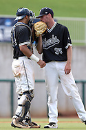 04 June 2016: Nova Southeastern's Jonny Ortiz (35) talks with Jake Anchia (14). The Nova Southeastern University Sharks played the Millersville University Marauders in Game 14 of the 2016 NCAA Division II College World Series  at Coleman Field at the USA Baseball National Training Complex in Cary, North Carolina. Nova Southeastern won the game 8-6 and clinched the NCAA Division II Baseball Championship.