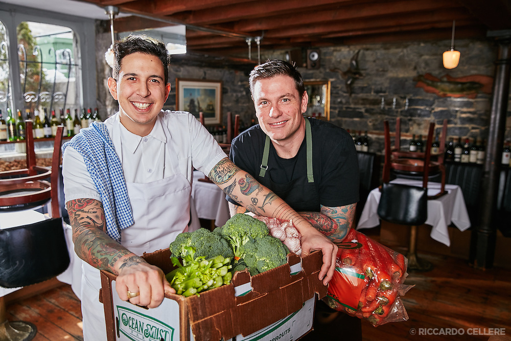 Chef Chuck Hughes and Chef Danny Smiles in the kitchen at Le Bremner restaurant in Montreal. Promo photo for Chuck and Danny's road trip.