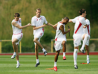 Photo: Chris Ratcliffe.<br />England Training Session. FIFA World Cup 2006. 29/06/2006.<br />From left, Michael Carrick, Peter Crouch, Ashley Cole and John Terry in training.