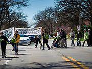 "14 APRIL 2019 - DES MOINES, IOWA: People participate in the Palm Sunday procession for peace in Des Moines. About 200 people participated in an interdenominational  Palm Sunday procession calling for peace. The theme of the procession was ""To Love and Defend our Sacred Earth"", it was sponsored by Des Moines Faith Committee for Peace.    PHOTO BY JACK KURTZ"