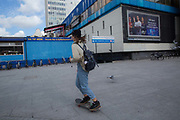 A female skateboarder at Elephant and Castle shopping centre on 17th September 2015 in Lambeth, South London, United Kingdom.